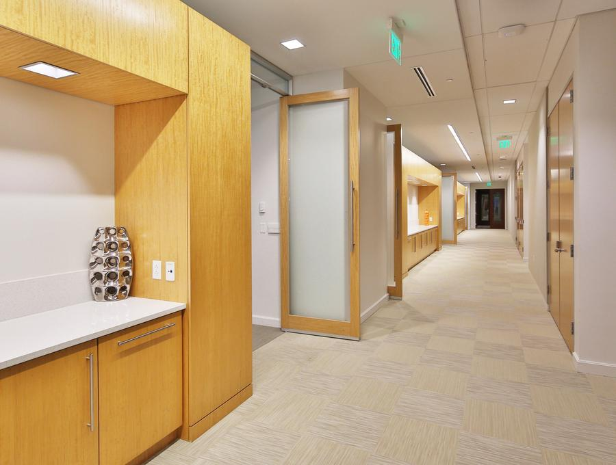 Built-in cabinetry lines the corridors