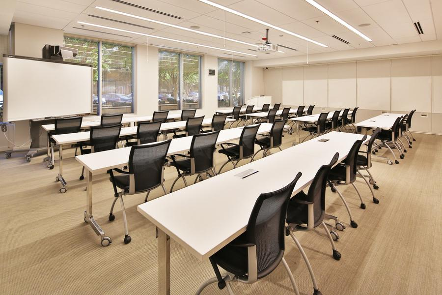 Large training room with modular tables and partitions. This room can be three times this size or closed off to have three separate smart rooms.