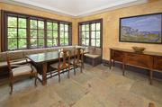 This family dining room has a banquet bench on two sides and a deep tray ceiling.
