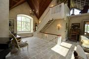 Another view of the main living area on the second floor. The staircase leads up to the guest room loft.