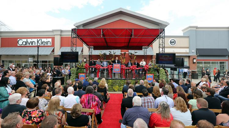 11ee9af0 A large crowd gathered for the mid-2016 grand opening of the Tanger Outlets  in