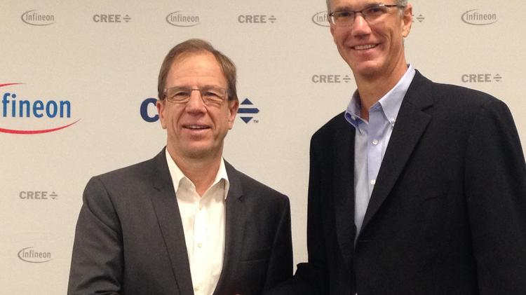 Cree CEO Chuck Swoboda (right), Infineon CEO Reinhold Ploss announced the deal in July.