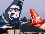 Virgin America boosts Alaska Airlines' February traffic; storms hit on-time flights