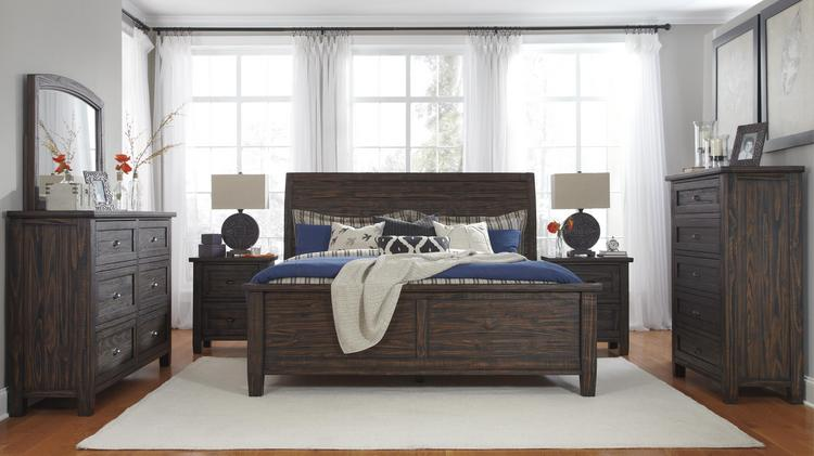 A Wooden Bedroom Set Produced By Ashley Furniture And Sold At Royal  Furniture Locations