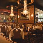 A baby grand piano, racy photos and dry-aged beef: You can have it all at Jeff Ruby's
