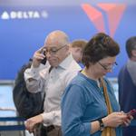 Delta cancels hundreds of flights due to global outage; trouble could last for days (Video)
