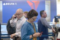 Delta Air Lines eases Medallion status rules, offers free changes for basic economy