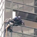 SNAPSHOT: Rain & flood warnings; K-9 saves the day; Man climbs Trump Tower; Minnesotan killed in police