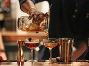 A bartender at Stoke Bar mixes up a Manhattan at the preview event.