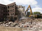 See demolition of Marquette University's former Jesuit Residence on Wisconsin Avenue