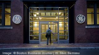 How do GE's corporate troubles reflect on Boston?