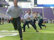 From last year's Best Places to Work Awards, held at U.S. Bank Stadium in Minneapolis: Employees from Best Places to Work winner Oggi Professional Services played football on the U.S. Bank stadium field.