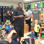 Thomas Davis, Panthers teammates surprise Charlotte students (PHOTOS)