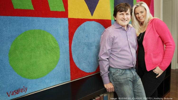 Charles Simonyi and his wife Lisa Simonyi stand in front of tapestry art by artist Victor Vasarely in their Puget Sound area home on Jan. 17, 2013. [the Simonyi family requests that their home address/neighborhood be confidential]