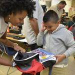 Ally Financial delivers school supplies to over 1,000 local students