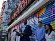 From left: Artist L'Amour Supreme, SBS Commissioner Greg Bishop, Tim Laughlin, executive director of the Lower East Side Business Improvement District, and EDC President Maria Torres-Springer.