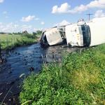 18-wheeler accident releases oil field waste on Karnes County road