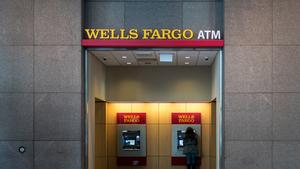 A customer uses the automated teller machine (ATM) at a Wells Fargo & Co. bank branch in Chicago, Illinois, U.S., on Saturday, April 9, 2016. Wells Fargo & Co. is scheduled to release earnings figures on April 14. Photographer: Christopher Dilts/Bloomberg