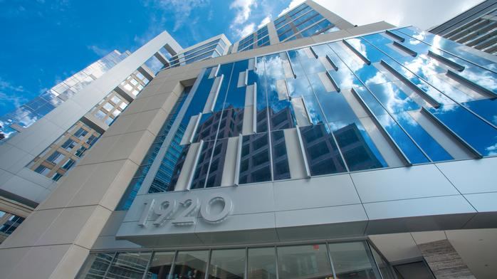 Avison Young's brokerage team returns to Uptown with swanky new office