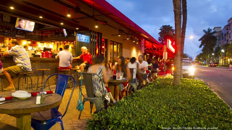 Patrons Enjoy Dining Outside At The Fat Rooster In Delray Beach