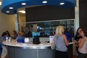 Customers and staff inside the new Blue Cross Blue Shield retail store in Greensboro. The carrier partnered with Triad Insurance Partners on the location.