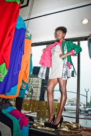 One of the live models standing in the windows exhibits an outfit combining the classic line with the Manuel's New Vision line.