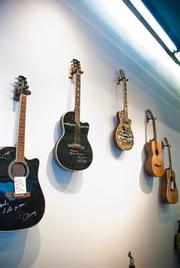 Guitars signed by famous musicians line the walls of the new building.