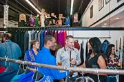 Jonathan Kayne, center, from Project Runway's season 3, talks with other guests from the event.