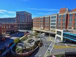 Hospital arms race wages on with apartments, physician practices