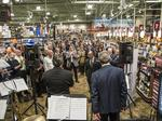 Clinking glasses - Community leaders celebrate opening of Total Wine: Slideshow