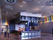 The front lobby features a 20-seat bar which also acts as the ticket counter.