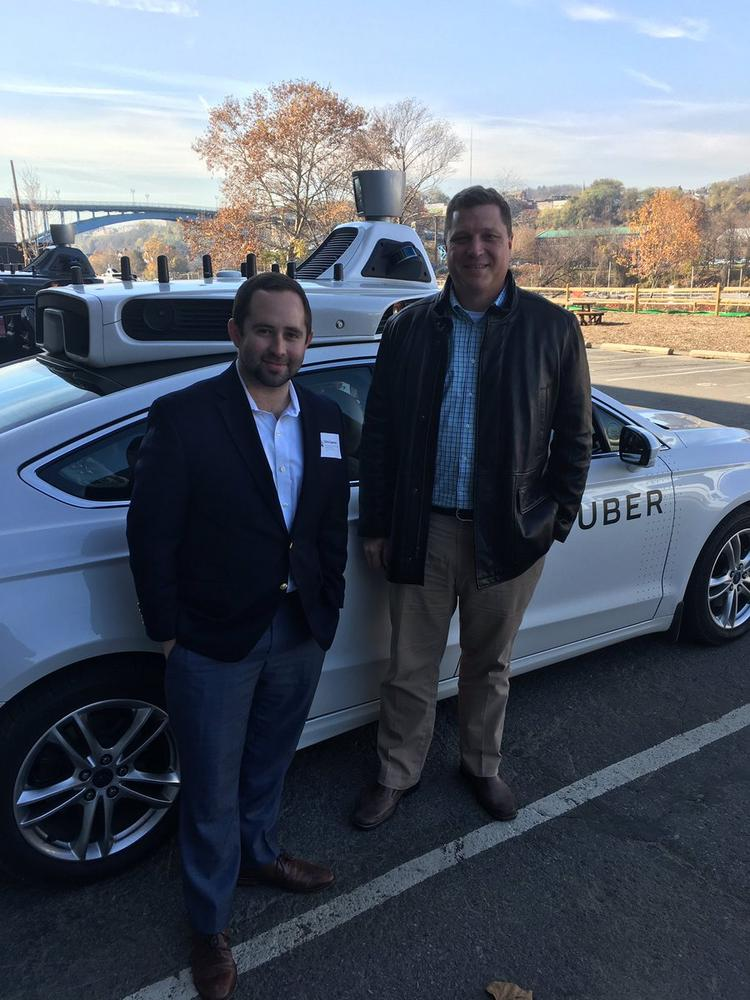 Florida Senator Jeff Brandes (right) poses with his legislative aide Chris Spencer before hopping into a fully autonomous Uber vehicle.
