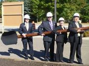Richfield Bloomington Honda General Manager Tim Carter, Richfield Bloomington Mitsubishi General Manager Brent Wade, Richfield Mayor Debbie Goettel and Mitsubishi Motors North America President and CEO Yoichi Yokozawa hold a giant shovel during Monday's groundbreaking ceremony.