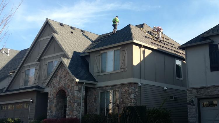 A crew from Legend Solar installs a residential solar energy system in Oregon.