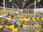 Wal-Mart, Amazon make headway on game-changing C. Fla. e-commerce centers