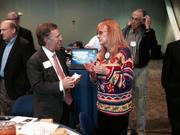 Jack Halpern talks to Rotary member Dianne Welsh after his presentation to the Rotary Club of Greensboro.