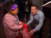 Brian Cornell, CEO of Target, with a St. Jude patient during St. Jude's annual Holiday Bullseye Bash, which is sponsored by Target.