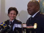 Incoming Police Chief Erika Shields, left, with Police Chief George Turner.
