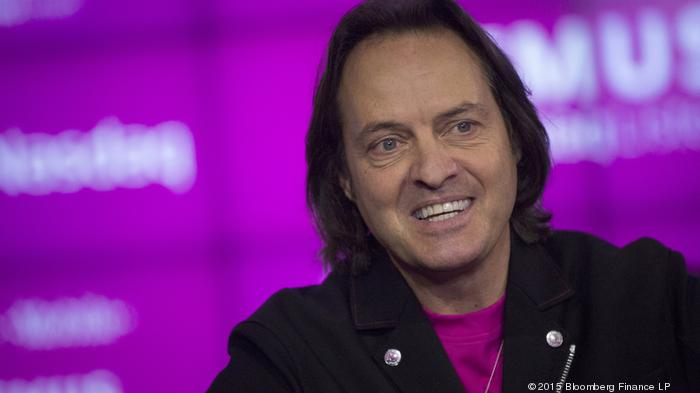 John Legere, chief executive officer of T-Mobile US Inc., speaks during a Bloomberg Television interview at the Nasdaq MarketSite in New York, U.S., on Tuesday, Oct. 27, 2015. Legere said he is pleased with T-Mobile's overall results despite missing third