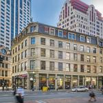 Synergy sells Boston office buildings for four times what it paid