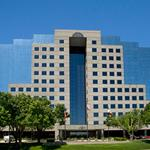 With biggest tenant hunting for new DFW office, Irving firm buys Addison tower