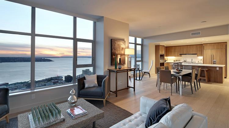Seattle Couple Lists Insignia Tower Corner Penthouse For