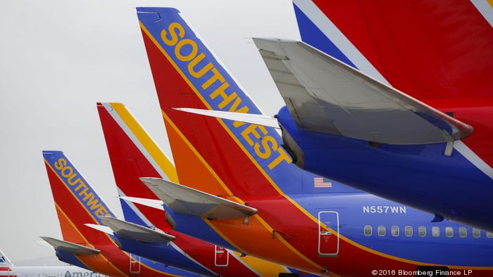 Southwest Airlines Co. Boeing Co. 737 aircraft sit on the tarmac at John Wayne Airport (SNA) in Santa Ana, California, U.S., on Thursday, April 14, 2016. Southwest Airlines Co. is scheduled to release earnings figures on April 21. Photographer: Patrick T.