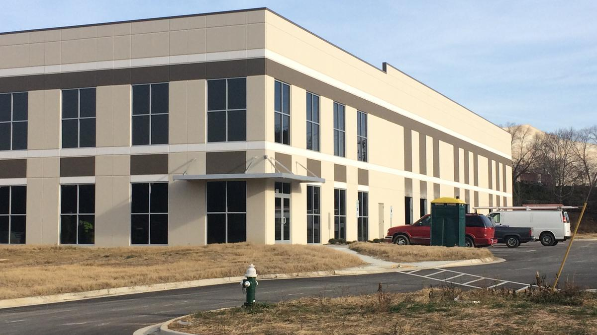 Simply southern tees entity buys greensboro spec building for Building a spec house