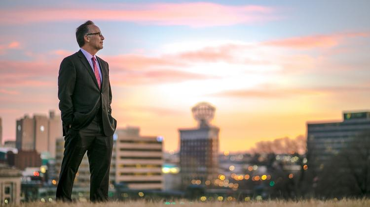 I love the way the early morning sunlight melds with the blurry city lights in the background of this image. This is Tim Cowden, CEO of the Kansas City Area Development Council.