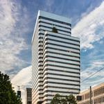 Prominent downtown office tower sells for 2016's highest price