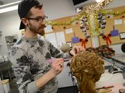 Benjamin Tremmel maintains a wig in the wig shop of the Guthrie. Wigs are reset and restyled once per week to keep them looking good through the extent of the show.