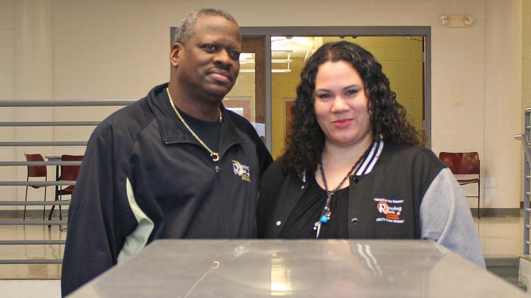 Husband and wife Victor and Dawn Barnett in the building's cafeteria and kitchen