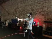 A customer at Matrix Arcade in Long Beach experiences a zombie attack in virtual reality, his mission being to destroy them with HTC hand controllers.