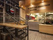 Toppers debuted a newer store design that features an open kitchen.
